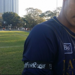 A handful of NU players pay tribute to UP's Rogie Maglinas