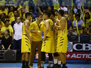 UST Growling Tigers huddle during the crucial stretch
