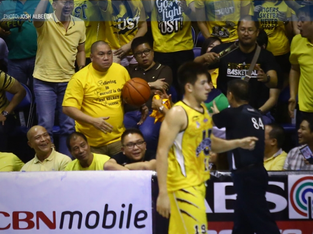 Coach Pido meets UST players after the game